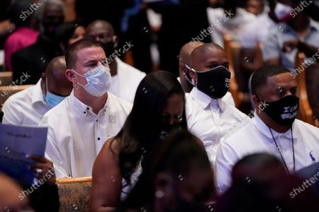 Stock Picture of Actor Channing Tatum, back left, sits with actor Jamie Foxx during the funeral service for George Floyd at the Fountain of Praise church, Houston, Texas, USA, 09 June 2020. A bystander's video posted online on 25 May, appeared to show George Floyd, 46, pleading with arresting officers that he couldn't breathe as an officer knelt on his neck. The unarmed Black man later died in police custody and all four officers involved in the arrest have been charged and arrested.