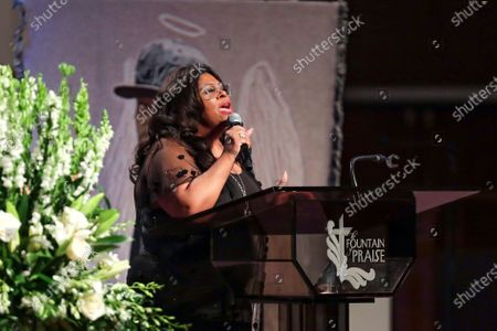 Stock Image of Pastor Kim Burrell sings 'God Will Take Care of You' during the funeral for George Floyd at The Fountain of Praise church in Houston, Texas, USA, 09 June 2020. A bystander's video posted online on 25 May, appeared to show George Floyd, 46, pleading with arresting officers that he couldn't breathe as an officer knelt on his neck. The unarmed Black man later died in police custody and all four officers involved in the arrest have been charged and arrested.