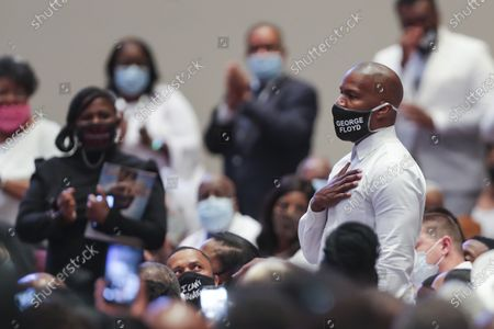 Actor Jamie Foxx is recognized by the Rev. Al Sharpton during the funeral for George Floyd at The Fountain of Praise church in Houston, Texas, USA, 09 June 2020. A bystander's video posted online on 25 May, appeared to show George Floyd, 46, pleading with arresting officers that he couldn't breathe as an officer knelt on his neck. The unarmed Black man later died in police custody and all four officers involved in the arrest have been charged and arrested.