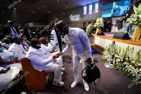 Actory Jamie Foxx, right, speaks with Rodney Floyd during the funeral service for George Floyd at the Fountain of Praise church, Houston, Texas, USA, 09 June 2020. A bystander's video posted online on 25 May, appeared to show George Floyd, 46, pleading with arresting officers that he couldn't breathe as an officer knelt on his neck. The unarmed Black man later died in police custody and all four officers involved in the arrest have been charged and arrested.