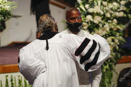 The Rev. Al Sharpton hugs actor Jamie Foxx during the funeral for George Floyd at The Fountain of Praise church in Houston, Texas, USA, 09 June 2020. A bystander's video posted online on 25 May, appeared to show George Floyd, 46, pleading with arresting officers that he couldn't breathe as an officer knelt on his neck. The unarmed Black man later died in police custody and all four officers involved in the arrest have been charged and arrested.