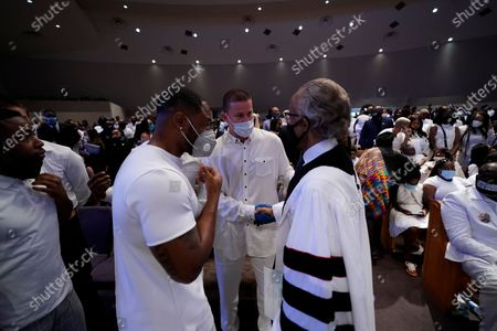 Actor Channing Tatum, center, speaks with the Rev. Al Sharpton, right, after the funeral service for George Floyd at the Fountain of Praise church, Houston, Texas, USA, 09 June 2020. A bystander's video posted online on 25 May, appeared to show George Floyd, 46, pleading with arresting officers that he couldn't breathe as an officer knelt on his neck. The unarmed Black man later died in police custody and all four officers involved in the arrest have been charged and arrested.