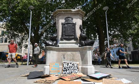 People look over the plinth of the Edward Colston statue in Bristol, Britain, 09 June, 2020. Merchant slave trader Edward Colston statue was pulled down during a Black Lives Matter protest 07 June. Protesters in across the UK continue to demonstrate in the wake of the death in police custody of George Floyd in the United States.
