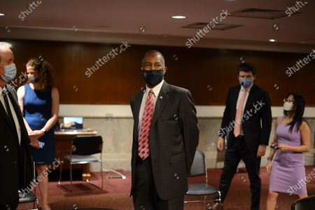 Benjamin S. Carson, center,  secretary of the U.S. Department of Housing and Urban Development, arrives to testify before the US Senate Committee on Banking, Housing, and Urban Affairs to examine housing regulations during the pandemic, on Capitol Hill in Washington, DC, USA, 09 June 2020.