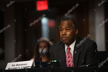 Benjamin S. Carson, center,  secretary of the U.S. Department of Housing and Urban Development, listens to questions of U.S. Senators during the US Senate Committee on Banking, Housing, and Urban Affairs hearing to examine housing regulations during the pandemic, on Capitol Hill in Washington, DC, USA, 09 June 2020.