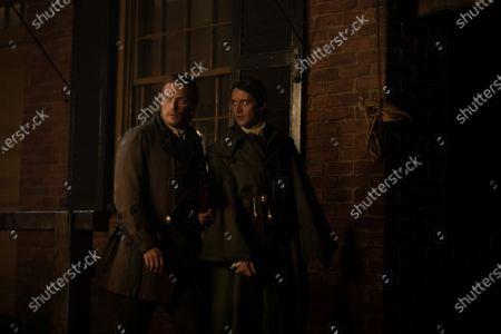 Sam Heughan as Jamie Fraser and Cesar Domboy as Fergus