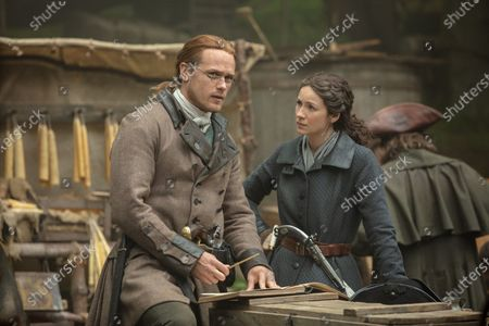 Sam Heughan as Jamie Fraser and Caitriona Balfe as Claire Randall