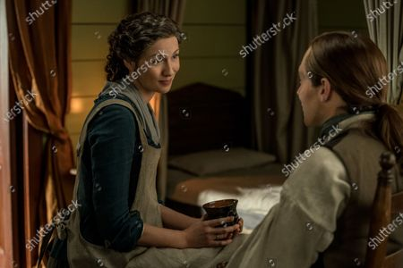 Caitriona Balfe as Claire Randall and Richard Rankin as Roger Wakefield