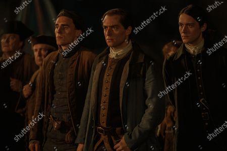 Stock Image of Cesar Domboy as Fergus, Richard Rankin as Roger Wakefield and Jon Tarcy as Isaiah Morton