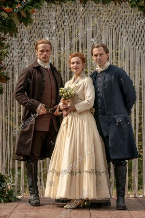 Sam Heughan as Jamie Fraser, Sophie Skelton as Brianna Randall Fraser and Richard Rankin as Roger Wakefield