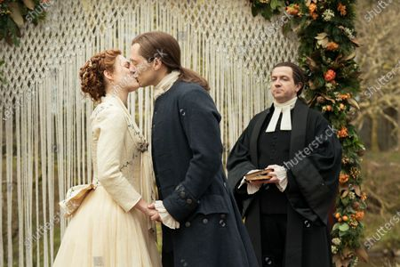 Stock Image of Sophie Skelton as Brianna Randall Fraser, Richard Rankin as Roger Wakefield and Mark Cox as Reverend Caldwell
