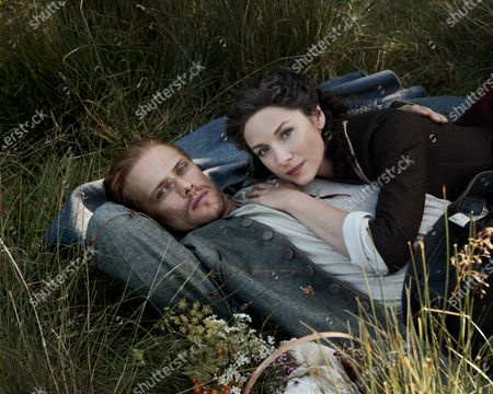 Stock Photo of Sam Heughan as Jamie Fraser and Caitriona Balfe as Claire Randall