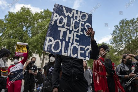Protesters gather outside Downing Street shortly after marking the funeral of George Floyd with a minuteÕs silence in Parliament Square. Protests have taken place across the United States and in cities around the world in response to the killing of George Floyd by police officers in Minneapolis on 25 May.