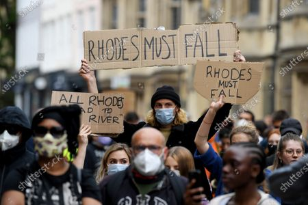 Protesters demand the statue of imperialist Cecil Rhodes be removed from Oriel College, Oxford.
