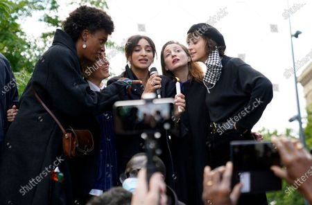 French singers, including Camelia Jordana (C), Pomme (R) and  Jeanne Added (2-L) sign 'We Shall Overcome' as protesters take part in a demonstration to show support for the George Floyd protests and denounce police brutality and racism, on Place de la Republique in Paris, France, 09 June 2020. Protesters gathered as of 6pm local time, coinciding with the funeral of George Floyd in Houston, Texas - after he was killed in police custody in the US on 25 May 2020 sparking protests across the United States and globally.