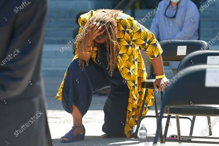 State Sen. Holly Mitchell, D-Los Angeles, Bows her head as she and other members of the California Legislature kneel for 8 minutes and 46 second to honor George Floyd at the Capitol in Sacramento, Calif