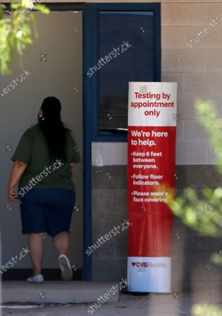 Patron with an appointment lines up at the St. Vincent de Paul Clinic to get a coronavirus test as the clinic has partnered with CVS Health to provide the testing, in Phoenix