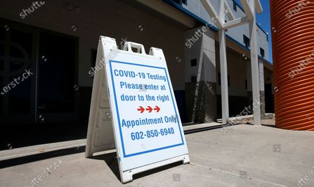 Sign directs people with appointments to line up at the St. Vincent de Paul Clinic to get a coronavirus test as the clinic has partnered with CVS Health to provide the testing, in Phoenix