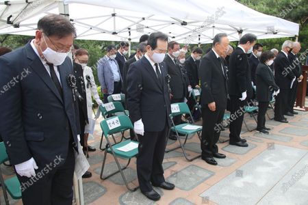 Stock Picture of South Korea's Prime Minister Chung Sye-kyun (2-L) pays tribute during a memorial to mark the first anniversary of the death of Lee Hee-ho, the widow of late President Kim Dae-jung, at the National Cemetery in Seoul, South Korea, 10 June 2020.
