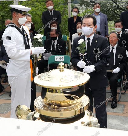 Prime Minister Chung Sye-kyun (R, front) offers a flower during during a memorial to mark the first anniversary of the death of Lee Hee-ho, the widow of late President Kim Dae-jung, at the National Cemetery in Seoul, South Korea, 10 June 2020.