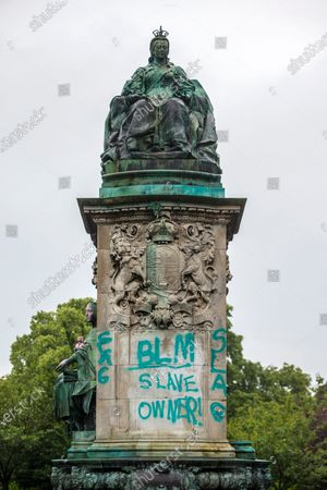 """A statue of Queen Victoria at Hyde Park in Leeds has been sprayed with graffiti including the words """"murderer"""" and """"slave owner"""". The bronze sculpture on Woodhouse Moor in the Hyde Park area of the city also had the words """"coloniser"""" and """"racist"""" daubed on it.Several statues have been targeted after a statue of 17th Century slave trader Edward Colston was torn off its plinth in Bristol by protesters."""