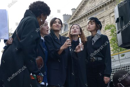 Stock Picture of Camelia Jordana, Pomme and Jeanne Added. Gathering at Place de la Republique in Paris to pay tribute to George Floyd, at the time of his funeral and to fight racism in the police. George Floyd died after his arrest by a police officer. 8 minutes 46 seconds of silence were observed at the request of SOS Racisme, in reference to its long agony.