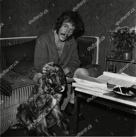 Peter Wyngarde relaxing at home.