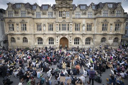 Campaigners sit in the road outside Oriel College at Oxford University, where they are calling for the removal of a statue of controversial imperialist Cecil Rhodes. Black Lives Matter protesters recently pulled down a statue of slave trader Edward Colston in Bristol town centre, following the death of George Floyd in the USA