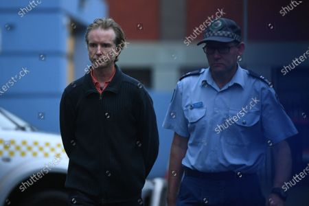 Jonathan Peter Doig (L) leaves Sutherland Police Station in Sydney, Australia, 10 June 2020. Doig, a Greens party federal election candidate, who allegedly paid to watch and direct the live stream of a child being sexually abused in the Philippines, has been granted strict conditional bail.