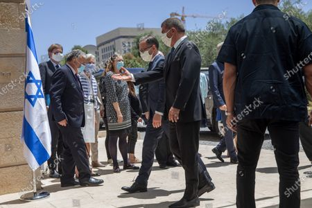 Israeli Foreign Minister Gabi Ashkenazi, right, welcomes his German counterpart Heiko Mass, as they wear protective face masks due to the coronavirus outbreak, prior to their meeting in Jerusalem