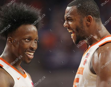 Clemson guard John Newman III, left, is congratulated by Aamir Simms after hitting a three-point shot against Duke during first-half action