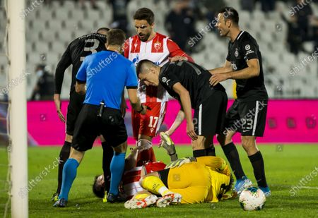 Stock Picture of Goalkeeper Vladimir Stojkovic of Partizan goes down injured