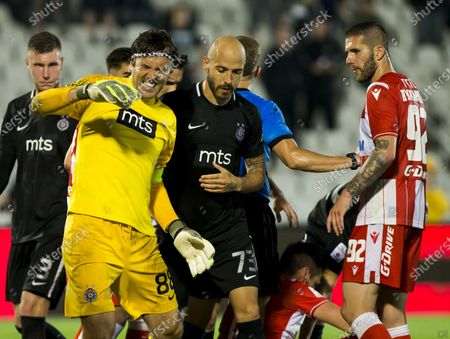 Goalkeeper Vladimir Stojkovic of Partizan reacts after the foul suffered