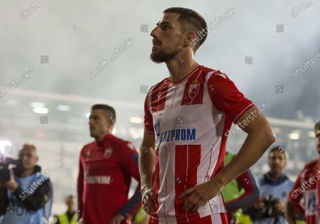 Milos Degenek of Crvena Zvezda looks deject after defeat