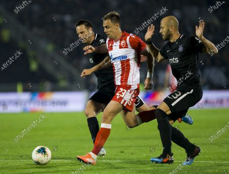 Milan Rodic of Crvena Zvezda competes against Bojan Ostojic of Partizan and Nemanja Miletic of Partizan