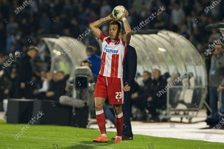 Milan Rodic of Crvena Zvezda puts the ball back into play from the side