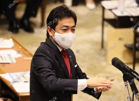 Japanese opposition Democratic Party for the People Yuichiro Tamaki wearing a face mask answers a question at Lower House's budget committee session at the National Diet in Tokyo on Wednesday, June 10, 2020. Lower House passed a record 31.9 trillion yen second supplementary budget bill to fight against outbreak of the new coronavirus.