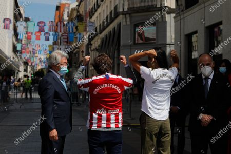 President of Atletico Madrid club Enrique Cerezo (L), Madrid's Mayor Jose Luis Rodriguez Almeida, Madrid's Deputy Mayoress Begona Villacis (2R) and President of LaLiga Javier Tebas (R) attend an event held in dowtown in Madrid to celebrate and support the resume of soccer games that where suspended due to coronavirus, 10 June 2020.