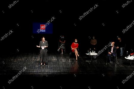 Spanish choreographer, ballerina and filmmaker Blanca Li (L), who currently serves as Director of the Theaters of the Canal, leads a discussion with the regional head of Madrid's Culture and Tourism Department, Marta Rivera (2-L), and the artistic director of the 'Madrid en danza' dance festival, Aida Gomez (3-R), during the presentation of a special edition of 'Madrid en danza' that is set to premiere now that the venue is reopening after nearly three months of closure due to the ongoing pandemic of the COVID-19 disease caused by the SARS-CoV-2 coronavirus, in the Chamberi district of Madrid, Spain, 10 June 2020.