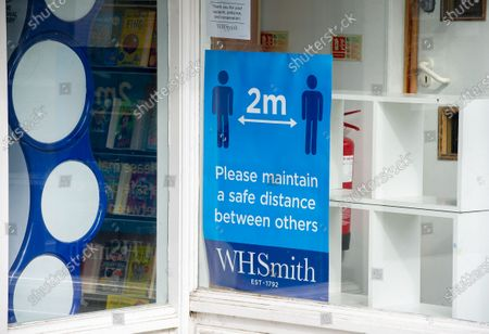 Stock Image of Stationery shop WH Smith in Windsor, Berkshire are getting ready to reopen and have put large social distancing signs in their windows. The Government has announced that non essential shops in England are allowed to reopen on 15th June 2020 following a relaxation in the lockdown rules