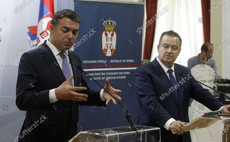 Ministers of Foreign Affairs of North Macedonia Vladimir Dimitrov (L) and Ministers of Foreign Affairs of Serbia Ivica Dacic (R) give statements to the media during the press conference after their meeting in The City Assembly House in Nis, Serbia, 10 June 2020.