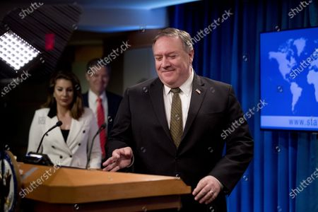 Secretary of State Mike Pompeo, accompanied by State Department spokeswoman Morgan Ortagus, left, and Sam Brownback, Ambassador at Large for International Religious Freedom, second from left, arrives for a news conference at the State Department in Washington