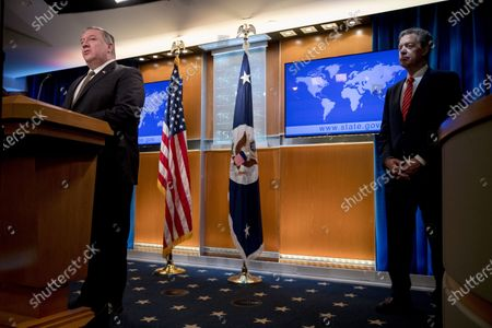 Secretary of State Mike Pompeo, Sam Brownback, Ambassador at Large for International Religious Freedom, right, speaks at a news conference at the State Department in Washington