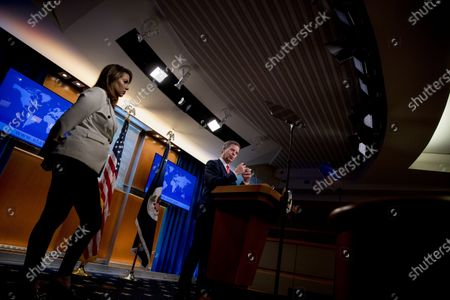Sam Brownback, Ambassador at Large for International Religious Freedom, center, accompanied by State Department spokeswoman Morgan Ortagus, left, speaks during a news conference at the State Department in Washington
