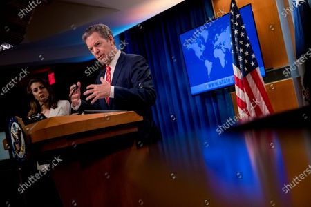 Sam Brownback, Ambassador at Large for International Religious Freedom, accompanied by State Department spokeswoman Morgan Ortagus, left, speaks during a news conference at the State Department in Washington