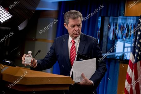 Sam Brownback, Ambassador at Large for International Religious Freedom, departs a news conference at the State Department in Washington