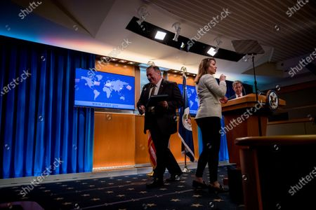 Stock Picture of Secretary of State Mike Pompeo, center, accompanied by State Department spokeswoman Morgan Ortagus, second from left, departs as Sam Brownback, Ambassador at Large for International Religious Freedom, right, takes the podium to speak during a news conference at the State Department in Washington