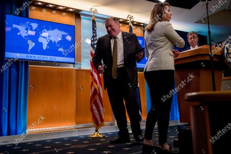 Secretary of State Mike Pompeo, center, accompanied by State Department spokeswoman Morgan Ortagus, second from left, departs as Sam Brownback, Ambassador at Large for International Religious Freedom, right, takes the podium to speak during a news conference at the State Department in Washington