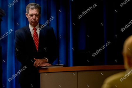 Sam Brownback, Ambassador at Large for International Religious Freedom, appears with Secretary of State Mike Pompeo at a news conference at the State Department in Washington
