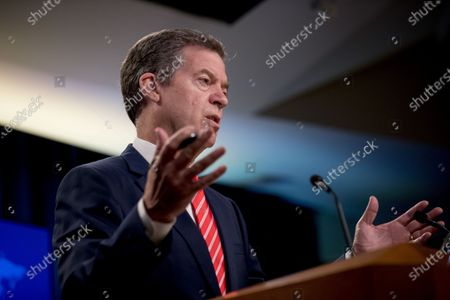 Stock Image of Sam Brownback, Ambassador at Large for International Religious Freedom, speaks during a news conference at the State Department in Washington